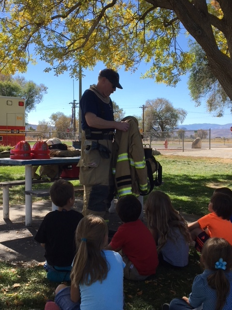 Capt. Hunewill and Chief Loveberg sharing with kids at Smith Valley  Elementary School for our annual Fire Prevention Week presentation.