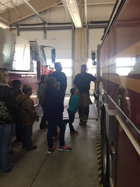 Firefighter Walker doing a fire station tour for His Word Christian Academy